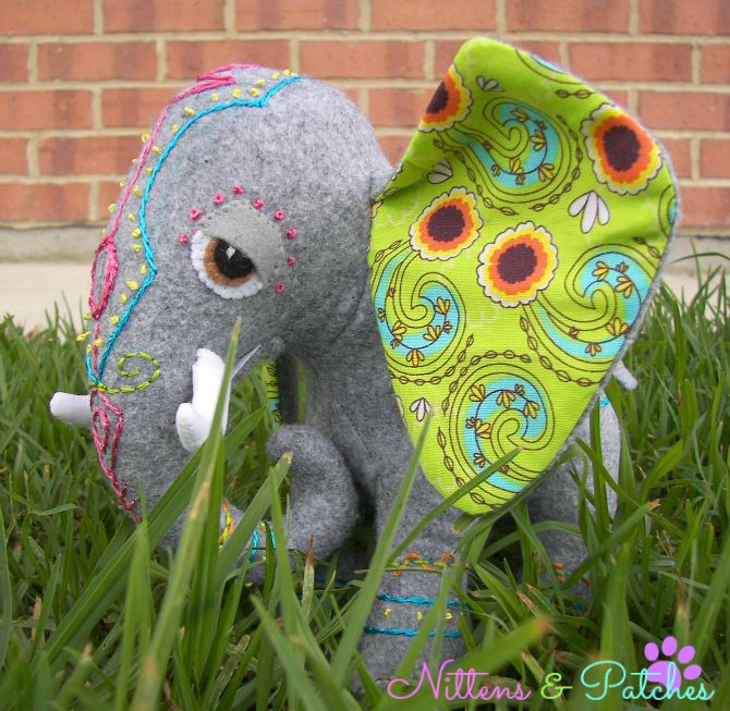 """This is a little elephant I made from a pattern in """"Stuffed Animals, from concept to creation"""" (book).  I decided she needed some decorations, so I embroidered decorated Indian elephant style designs on her.  :)"""