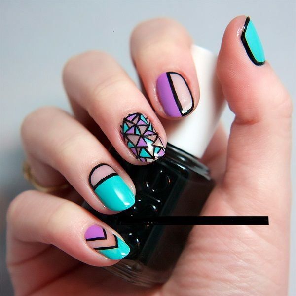 This trendy art design has an oriental look to it. The different designs on each nail make it a treat to look at.