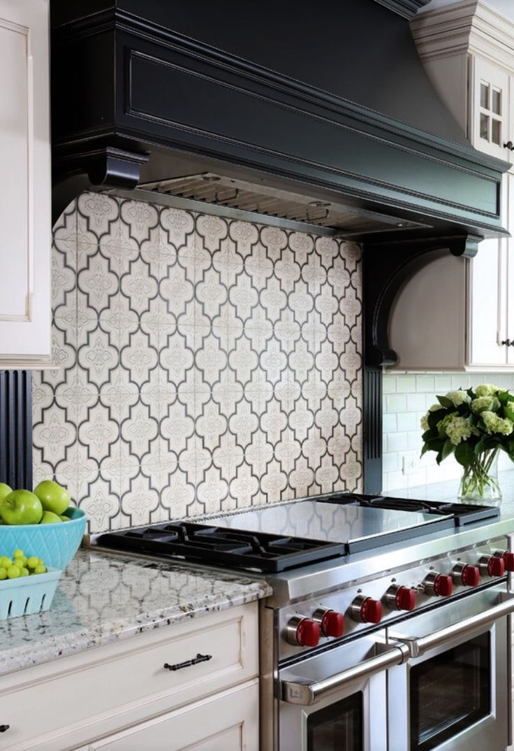 From our Artisan Stone Tile collection, the Keystone pattern makes a beautiful backsplash in a traditional kitchen.  By Normandy Remodeling