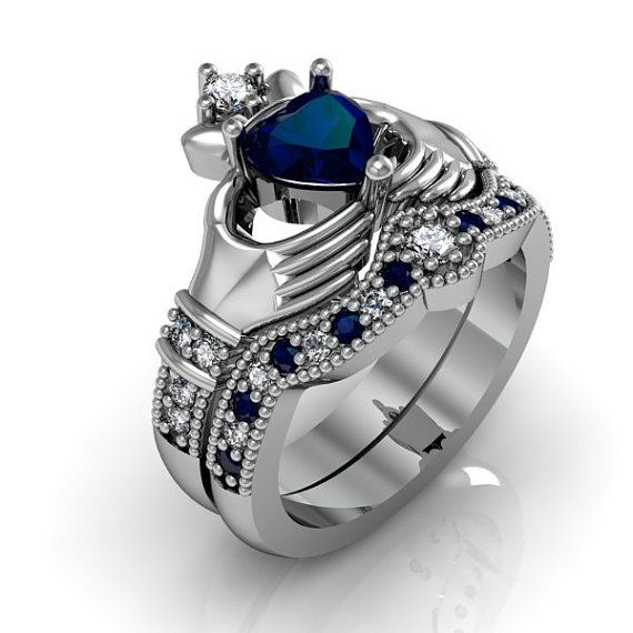 Claddagh Ring - Created Blue Sapphire Sterling Silver Love and Friendship Engagement Ring Set  Metal: .925 Sterling Silver  Gemstone: Created Sapphire (Cubic Zirconia)  Gem Quality: AAA  Gem Size 6mm Side Stones: AAA CZ  Band Stones: AAA CZ    You can custom order this ring in 14k 18k white or yellow gold, platinum and palladium. Please contact me for a quote.  Return Policy   Your Satisfaction is Guaranteed! If for any reason you are not completely satisfied with your purchase, you can…