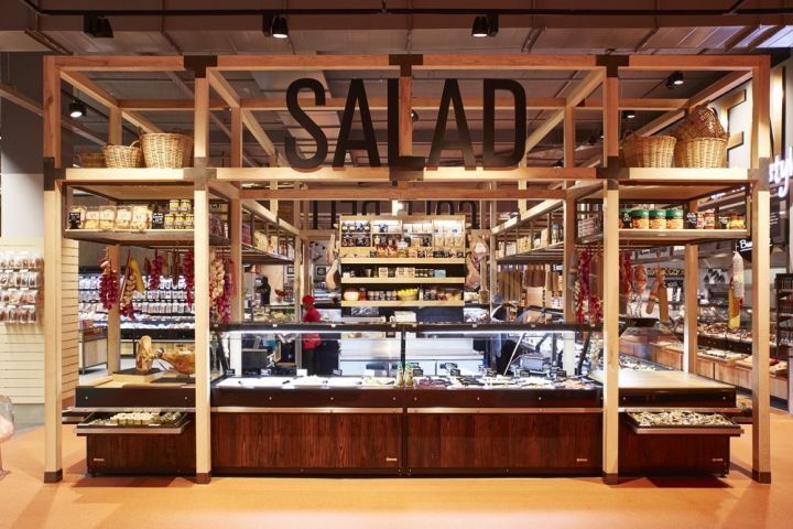 "Much of the design input was directed in creating the 'urban market', making it the heart of the store and main service node. This was anchored by a ""wine cellar"" to direct the shopper through the store into this market space."