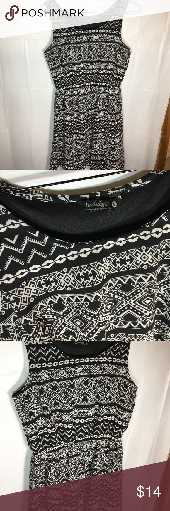 Indulge black and white tribal print dress size M Super cute and trendy tribal print dress in black and white.  Soft durable fabric, comfortable flow with black lining throughout, elastic waistband on skirt allows for movement but does not bunch or twist and creates more appealing bust line. Asymmetrical hem flattering for every body. Perfect for any occasion! Dresses