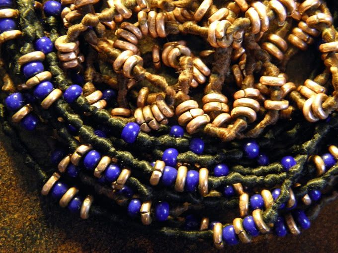 blue glass and copper beads on waxed cotton