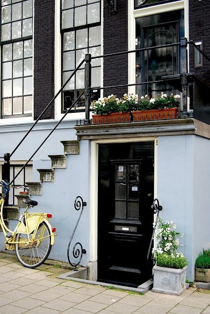 Amsterdam This is a house on one of the canals in the earlier years rich people lived here the people lived there taked the door above and the personal that worked for them must take the door down to the souterane