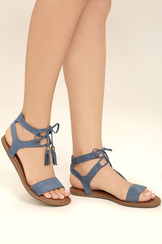 The Keely Blue Lace-Up Flat Sandals are perfect under that breezy maxi you've been eyeing! Soft vegan suede toe strap and ankle cuffs meet adjustable laces with tasseled ends.