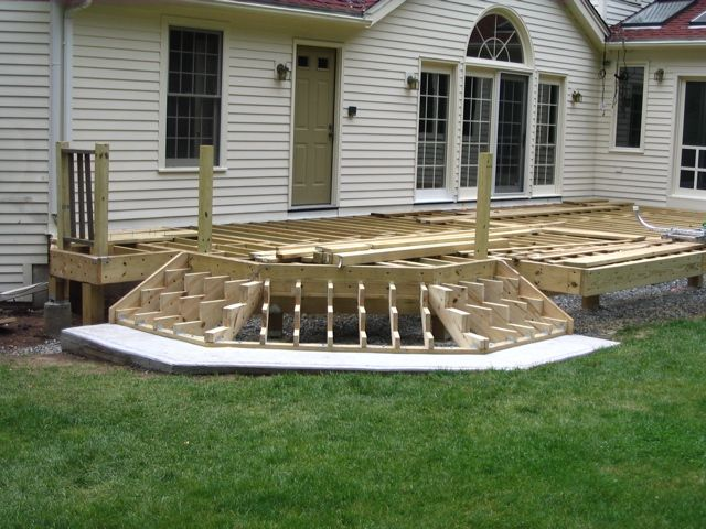 Deck stair construction cascading stair framing deck for Patio construction ideas