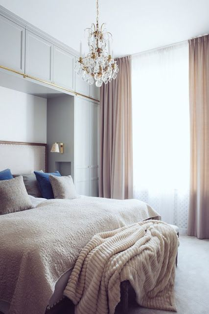 Bedroom Built in cupboards around bed with sconces and glasses/water niche