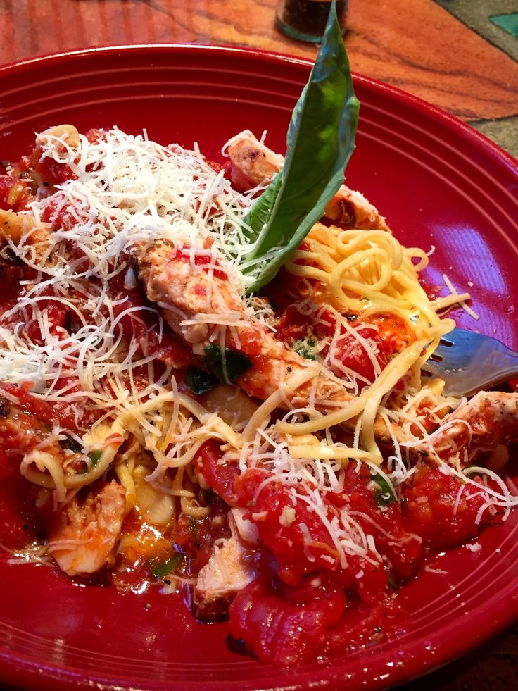 "Carrabba's ""Tag Pic Pac"" Meal.  (Tagliarini pasta with wood grilled chicken in Picchi Pacchiu sauce of crushed tomatoes, garlic, olive oil and basil)"