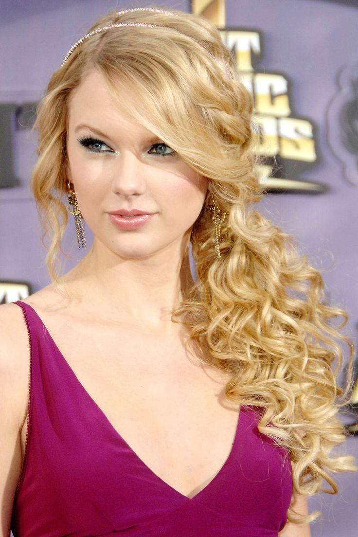 In her signature side bangs and curls at the CMT Music Awards. Getty Images  - HarpersBAZAAR.com