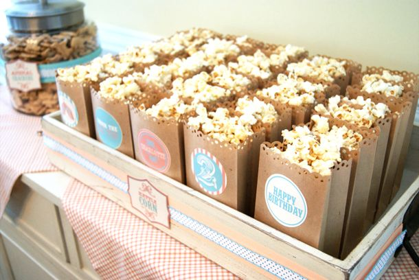 darling popcorn display: lunch sacks cut with decorative scissors + label stickers + vintage tray