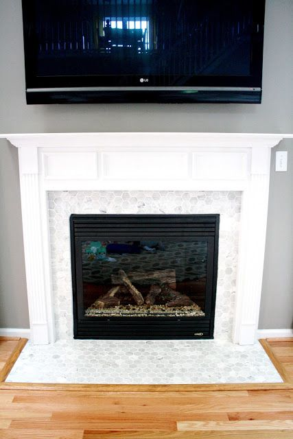 Faux fireplace mantle idea... I am building this w/ matching tile from my backsplash in the kitchen!!!!