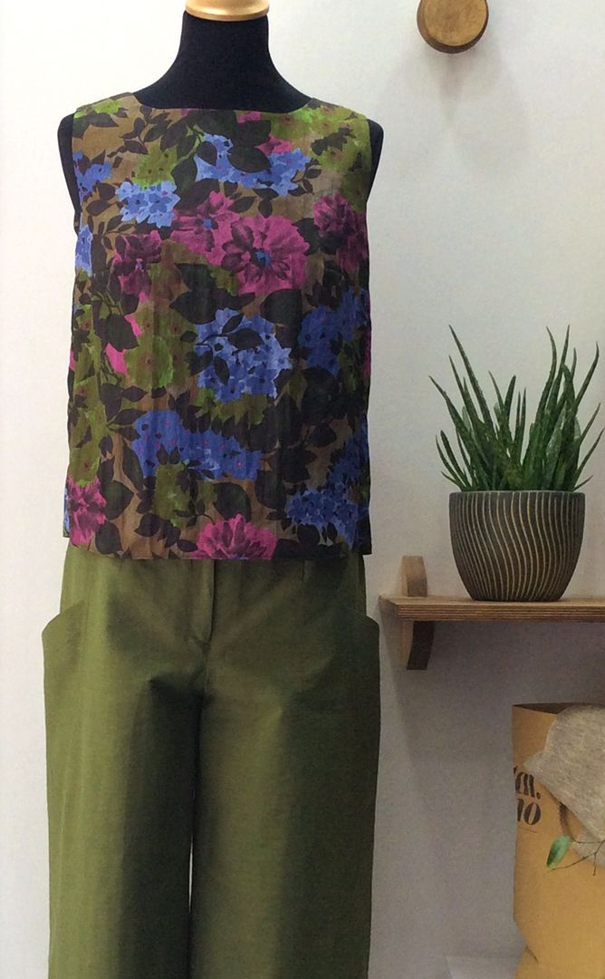 flower patterned polyester top and olive green grosgrain zip culotte