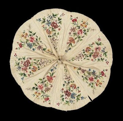 Embroidered parasol cover  French, 19th century France  DIMENSIONS:  61 x 61 x 1.5 cm (24 x 24 x 9/16 in.)  MEDIUM OR TECHNIQUE:  Silk with silk and metal bullion embroidery  CLASSIFICATION:  Costumes  ACCESSION NUMBER:  49.16  Museum of Fine Arts, Boston