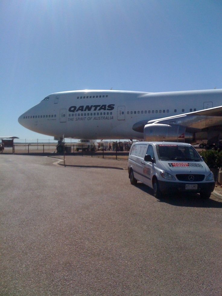 Leather Doctor van outside the Qantas outback museum at Longreach Queensland with a decommissioned 747 in the background.