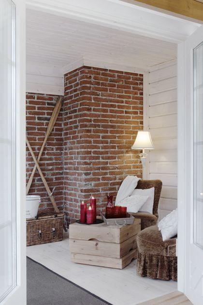 A nice combination of tile and log walls. #Honka