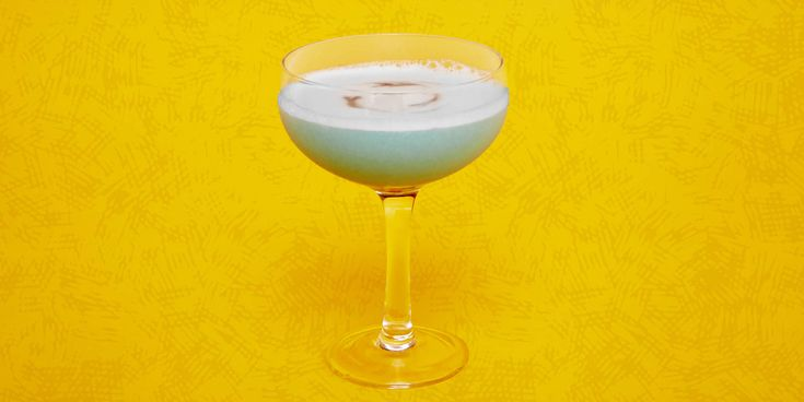 Space Oddity 1.5 oz pisco .75 oz Blue Curaçao .5 oz Lemon Juice 1 egg white 2 drops Orange Blossom Water 2 dashes Orange Bitters 3 drops Peychaud's Bitters