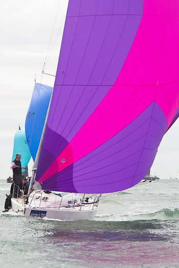 The J/109 yacht 'Jukebox' with spinnaker racing during Cowes Week 2013