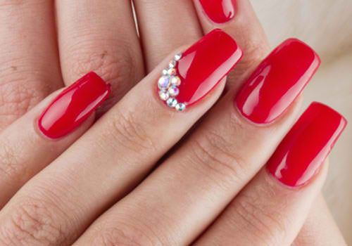 Long red nails with rhinestone are simply gorgeous.