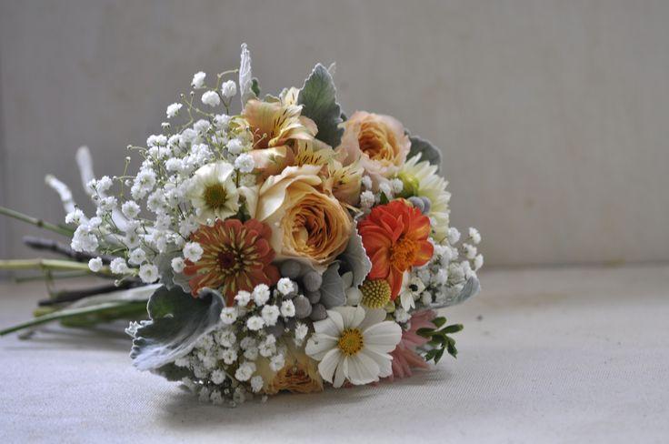 Bridesmaid bouquet of garden rose, freesia, ornithogalum, zinnia, crapsedia, alstromeria, senecio, cosmos www.vanessabirleyflorals.com