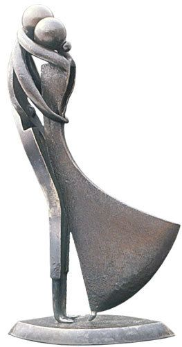 Sculpture by Jean-Pierre Augier. It looks to me like a Tomahawk head was used to make her dress.