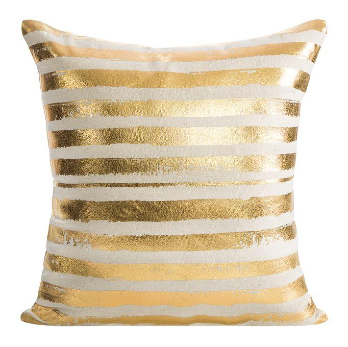 Złote poszewki na poduszki w białe paski