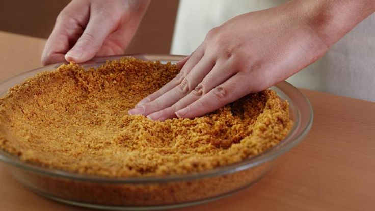 A homemade graham cracker crust is the perfect addition to cheesecakes and cream pies—make your own in two simple steps.