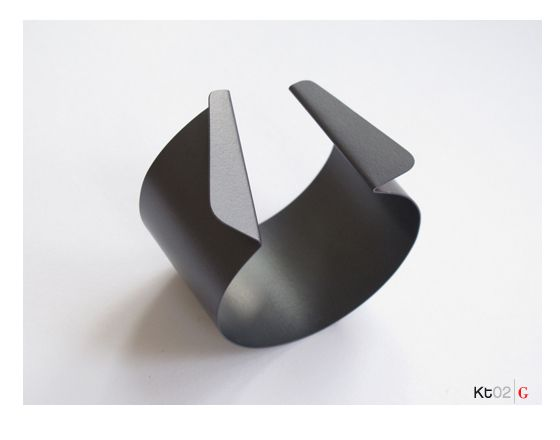 Bracelet by Fritz Maierhofer, 2011.  Aluminium, anodised in grey