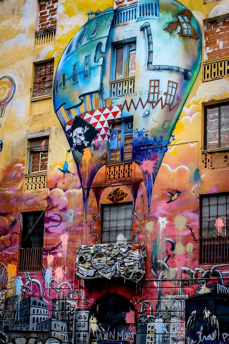 In Sant Antoni, Barcelona - painted in the façade of a squatter house called La Carboneria. The building between Urgell street and Floridablanca street will be demolished, so you want to go there quickly before it disappears.