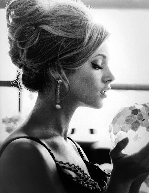 Love the tousled bed hair in a french bun and the winged eyeliner. Classy.