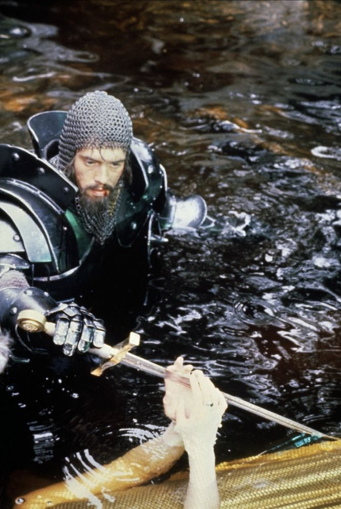 """Excalibur"" directed by John Boorman, 1981. Arthur receives a replacement sword from The Lady In The Lake. Or the Lady takes back the Sword as he lies dying: I'm not sure which...."
