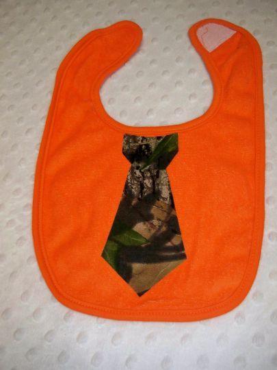 Orangebaby boy bib with camo tie embellishment.