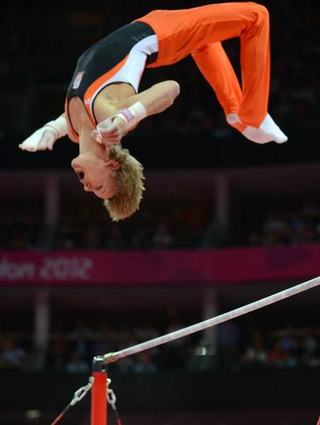 Dutch Epke Zonderland flies over the bar during his gold medal performance on the Men's Horizontal Bar during the Men's Gymnastics Apparatus Finals competition at the North Greenwich Arena during the London 2012 Summer Olympics in Greenwich, London on August 7, 2012.