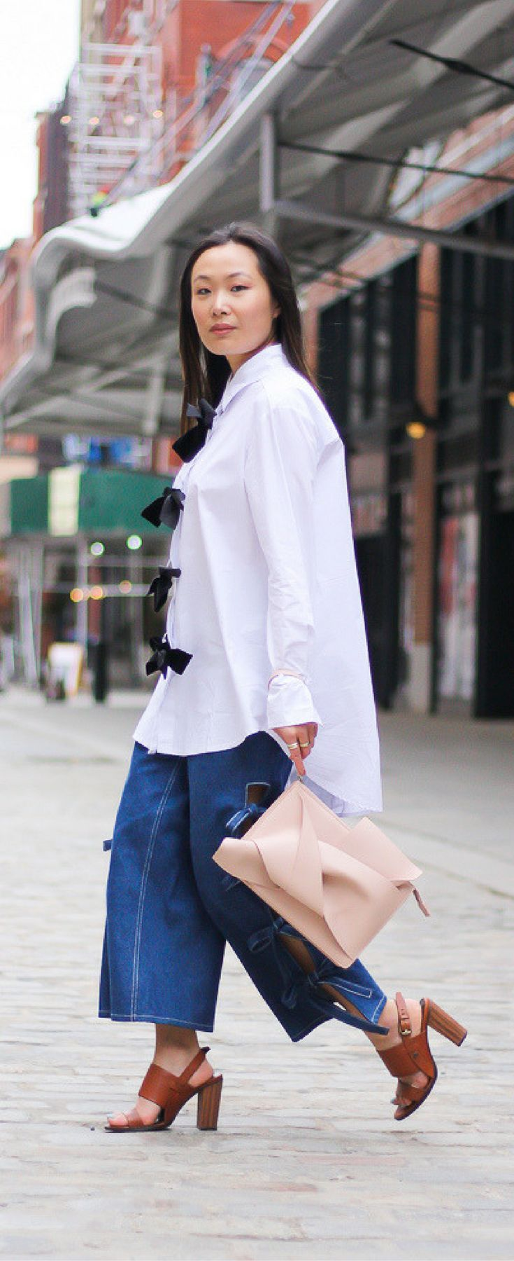bow shirt, bow jeans, street style cool girl. Get the look on www.layersofchic.com