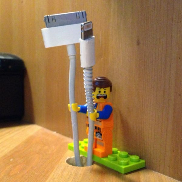 10 Ways to Control Cord Clutter - lego people hands fit perfectly around charging cords