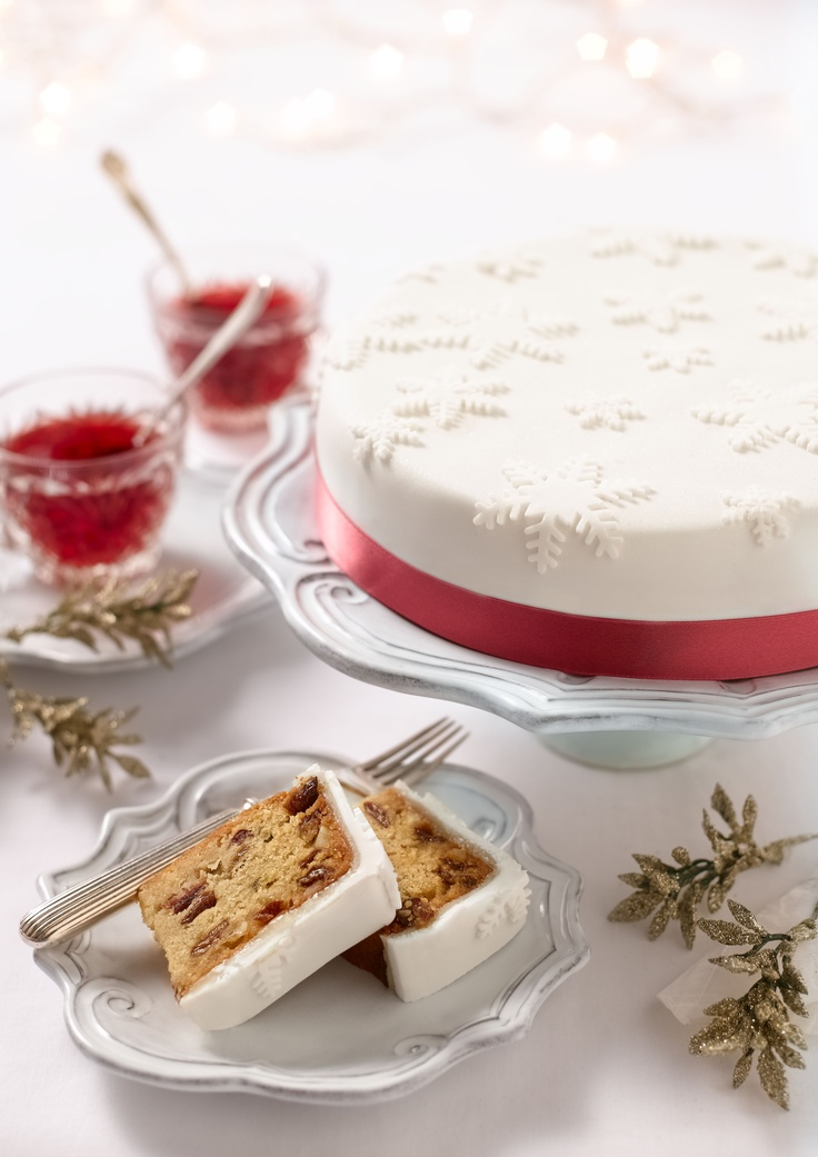 Christmas Fruit Cake – Chic and sophisticated, this elegant cake will make a great addition to your festive spread.  A blonde fruit cake made with demerara sugar, mixed fruits and cranberries, covered with a thin layer of sweet marzipan, and finished with a regal icing.