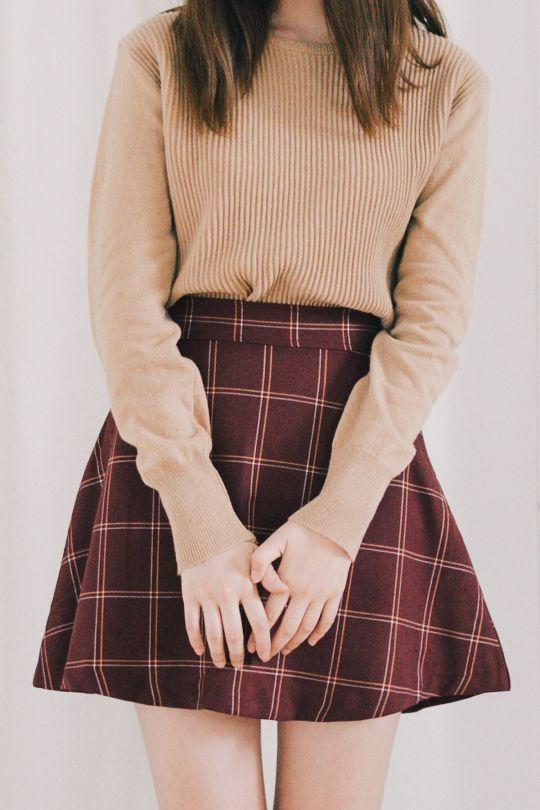- camel sweater and red plaid skirt                                                                                                                                                                                 More