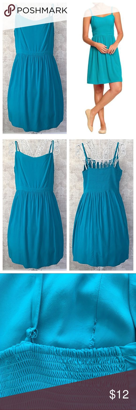Old Navy Cami Dress ⭐Host Pick!⭐ Old Navy turquoise poplin crepe cami dress, size XL Tall. Pull-on style with a banded waist, adjustable straps and a stretchy smocked back for a great fit. The front bodice is lined and there is a bit of loose stitching on the inside, right side of the dress. Because it's on the inside, it's not visible while wearing the dress. I did include a picture for reference. Otherwise in good used condition with lots of life left! Old Navy Dresses