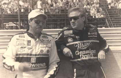 Dale Earnhardt chats with Rusty Wallace on pit road in 1993.