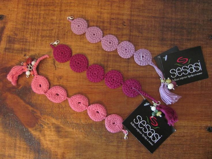 Knitted braceletes with rhinestone.