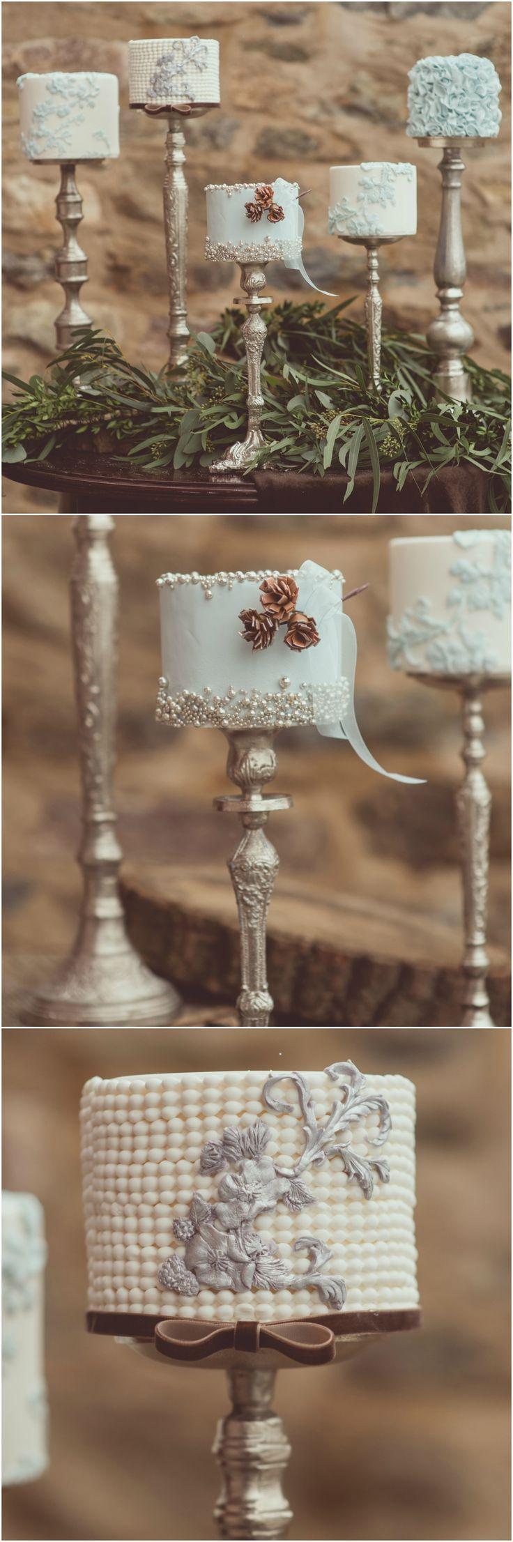 Petite wedding cakes, bronze candlesticks, edible pearls, lightest pastel blue fondant, light gray cutouts // Carla Ten Eyck Photography
