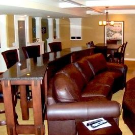Love the idea of a bar table behind the couch! Additional seating and a place to eat!