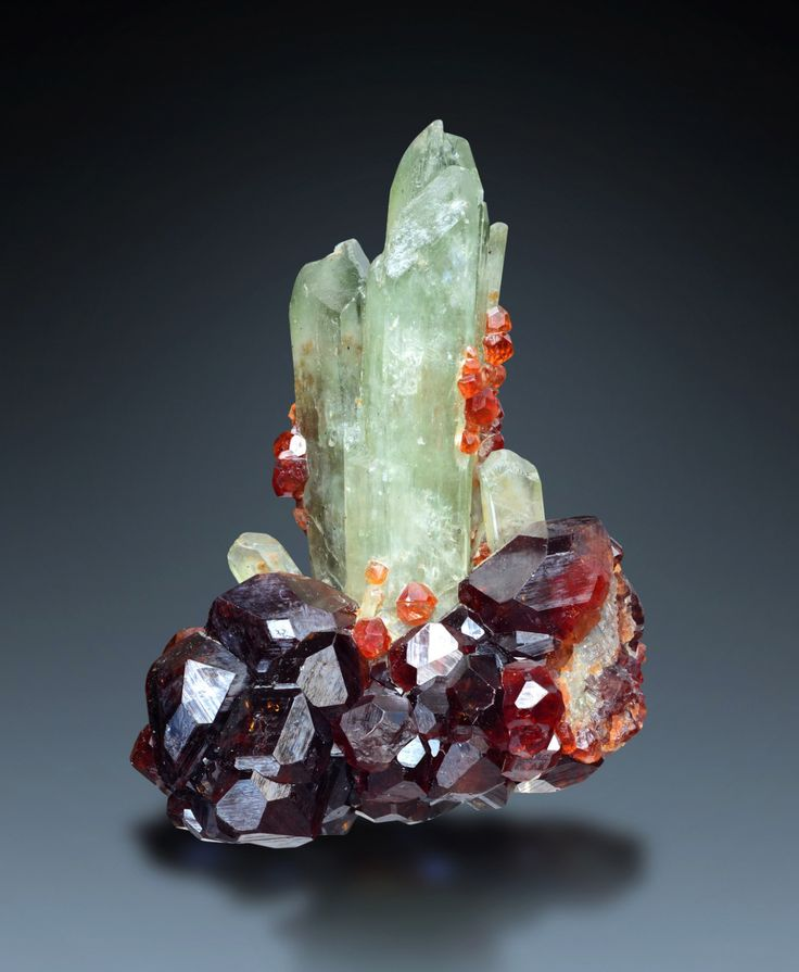 Hessonite and Diopside - Ala Valley, Lanzo Valleys, Torino Province, Piedmont, Italy. Looks a bit like a quartz cluster.