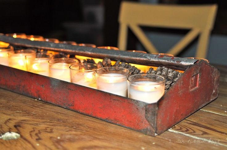 decorating with junk - an old toolbox makes a great holder for candles!
