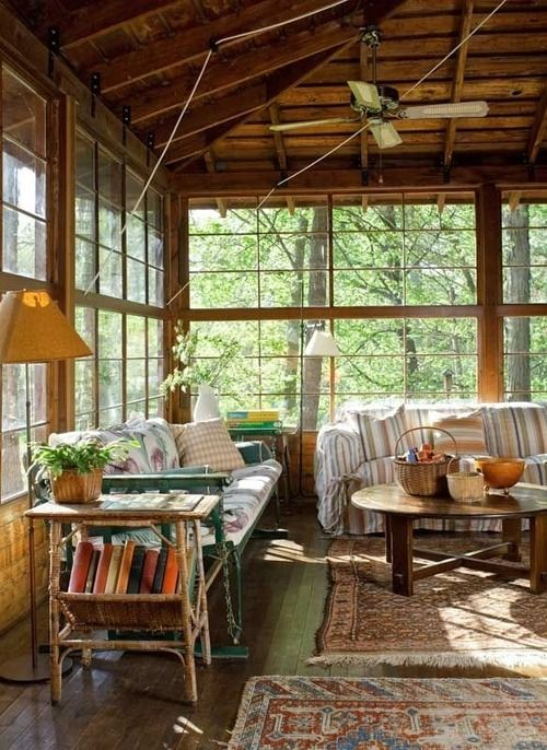 The furnished porch of a 100-yr-old lakeside family cabin, well-loved & well-used  #home