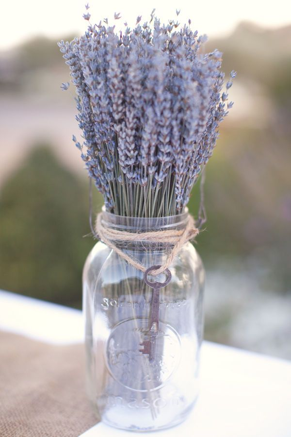 Love this mason jar with lavender! Centerpiece for navy & lavender wedding