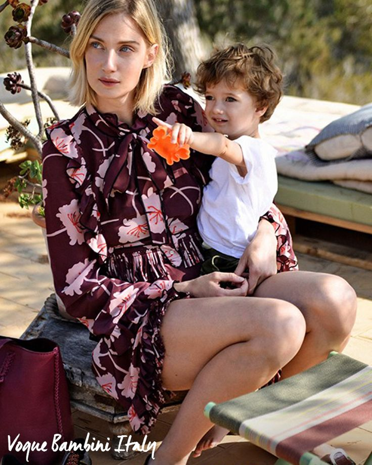 Easy elegance in a Fay floral dress. Eva Riccobono wears Fay and spends time with her son, as seen in Vogue Bambini.