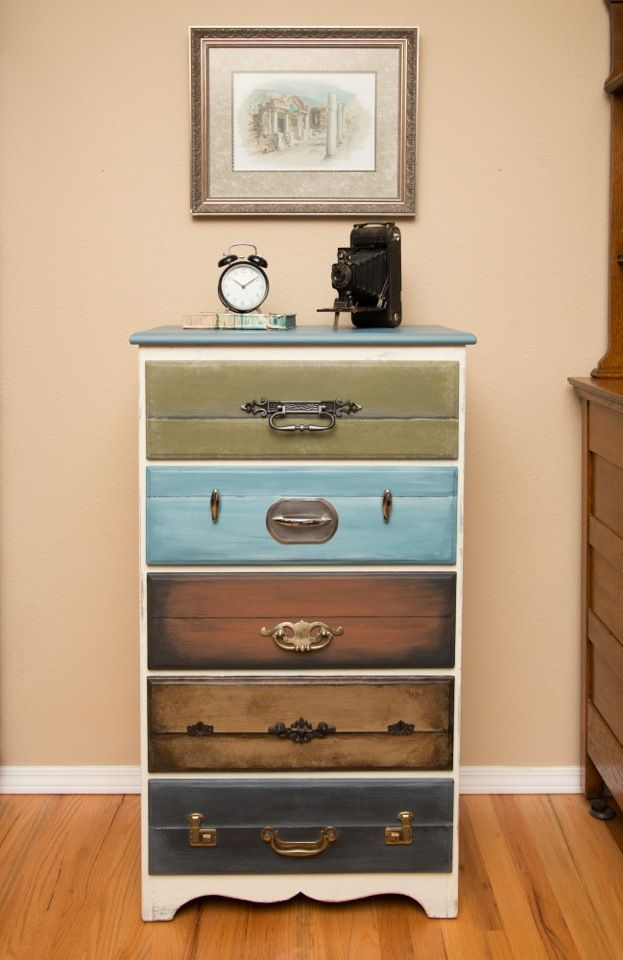 Dresser with drawers faux painted to look like suitcases.  Embellished with vintage latches.