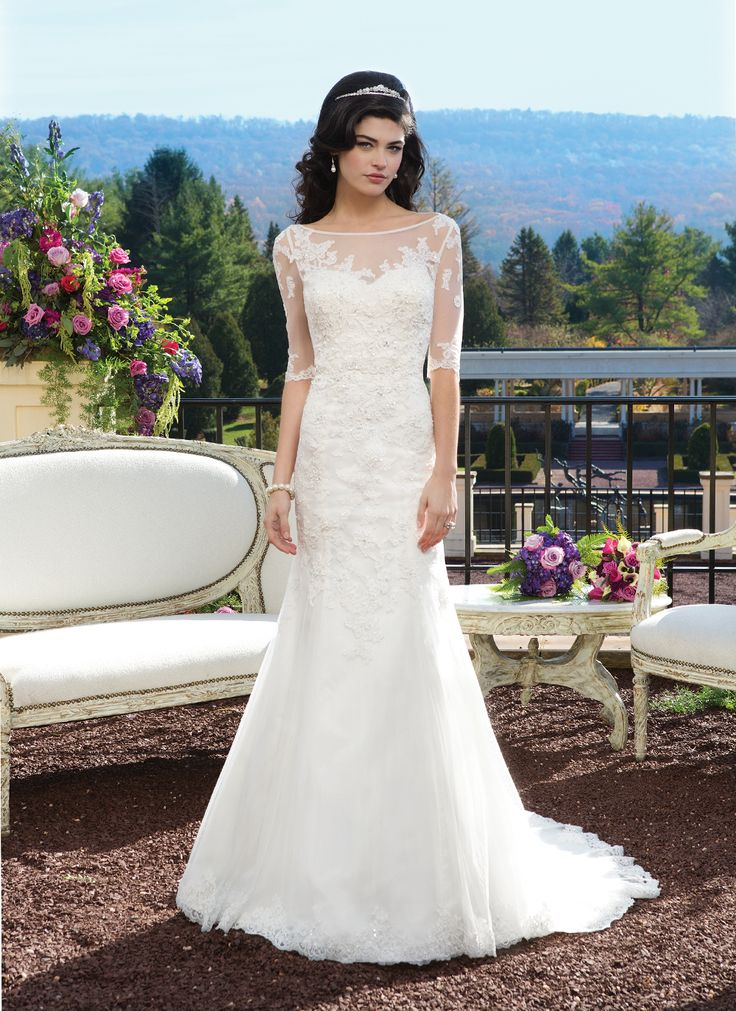Sincerity wedding dress style 3814 Beaded Alencon lace over tulle fit and flare gown with a sweetheart  neckline that features a Sabrina beaded Alencon lace over tulle  three-quarter length sleeve jacket and hemlace. The back is finished  with tulle covered buttons and a chapel length train.