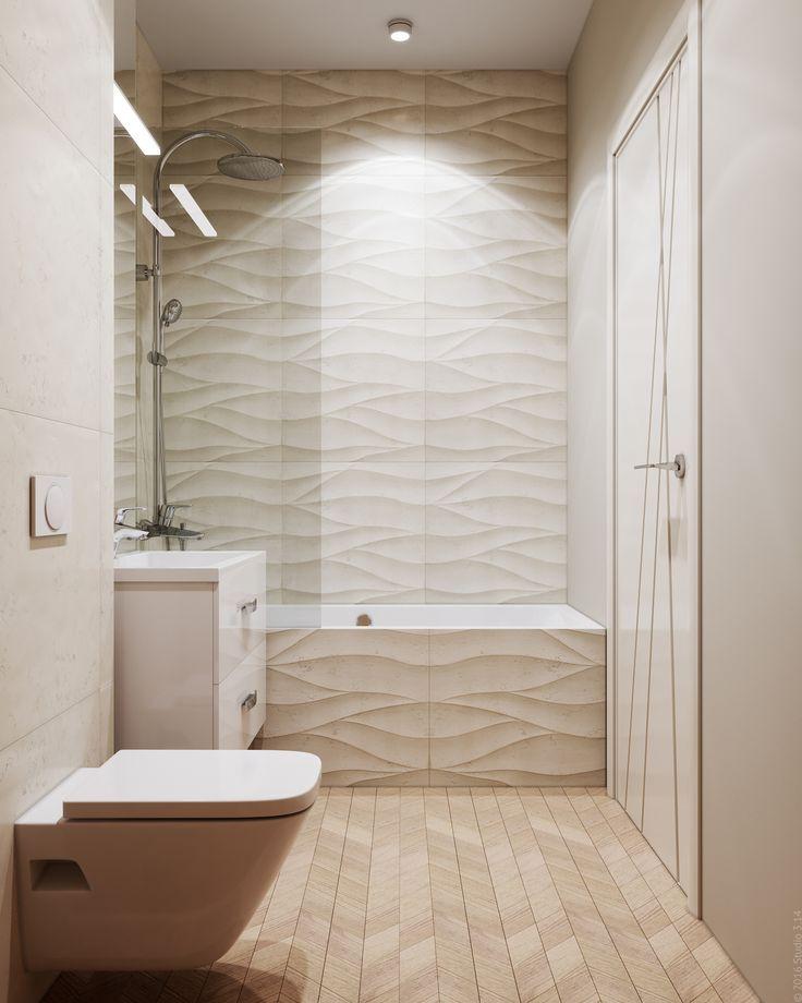 Зона ванной облицована плиткой с интересной волнистой фактурой.