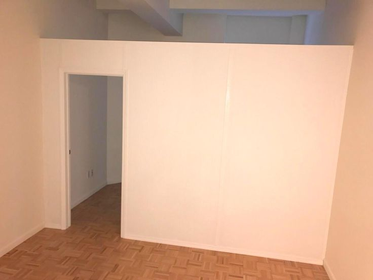 Standard temporary partition with swing door. Call us for all your custom room partition and storage inquiries. (646) 837-7300